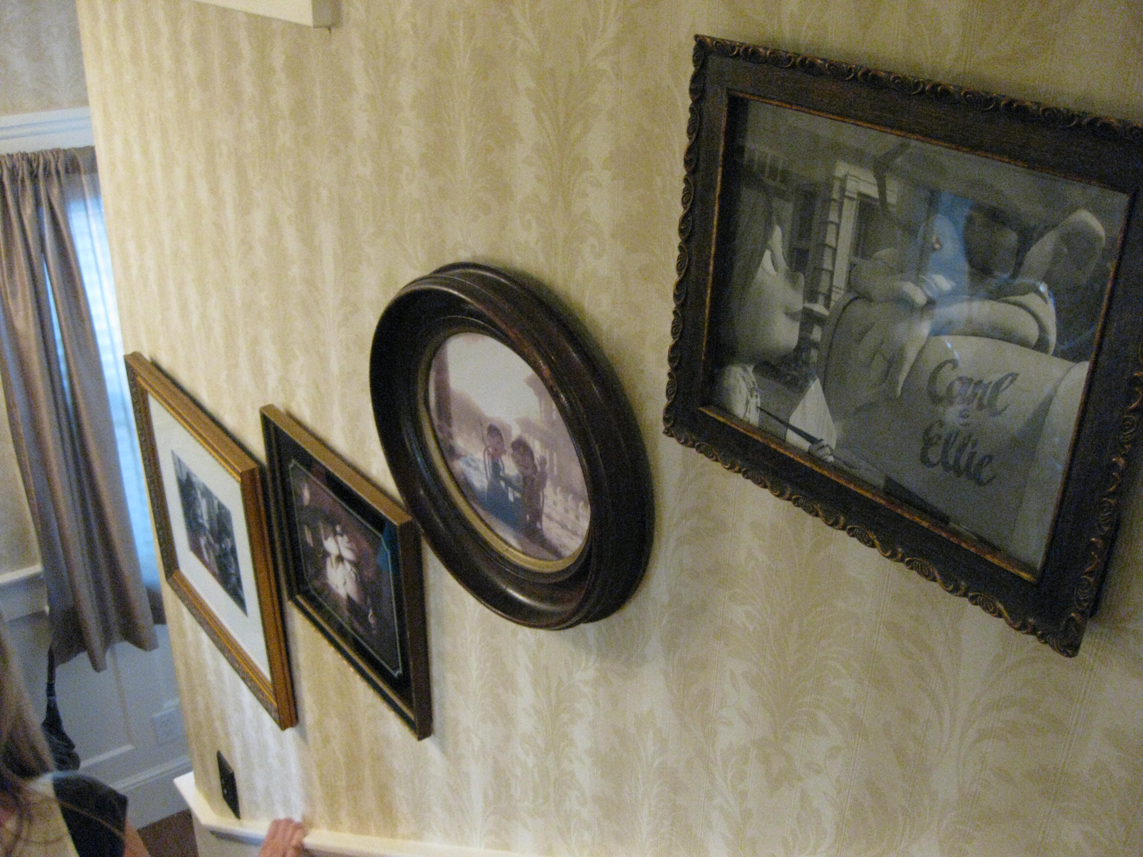 family photos going up staircase - Hooked on Houses