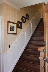 staircase and family photos wide shot