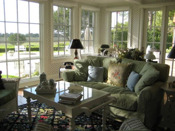 sunroom with green sofa