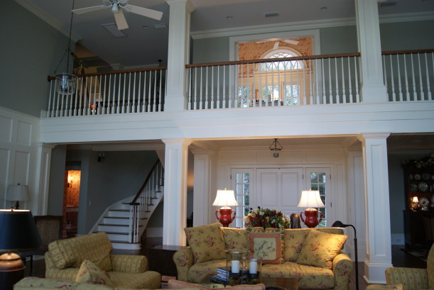 A two story living room with sofa