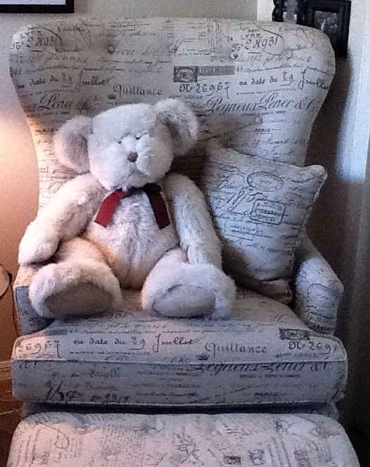 armchair with teddy bear sitting on it