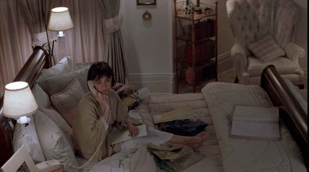 Sally Field talking on phone in bed