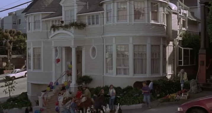 A group of people in front of Mrs. Doubtfire house