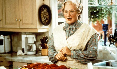 Euphegenia Doubtfire preparing food in a kitchen