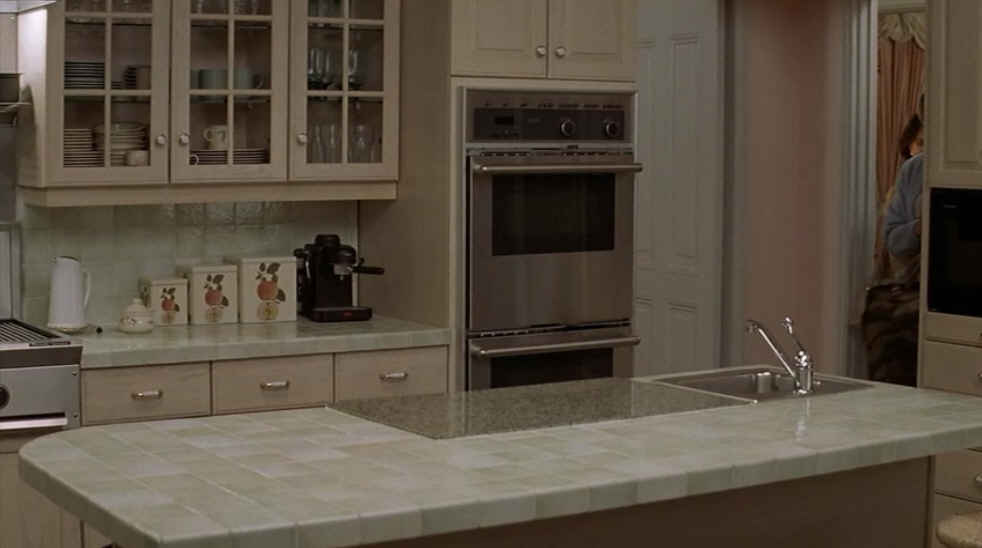 screenshot of kitchen in Mrs. Doubtfire with double ovens and tile countertops