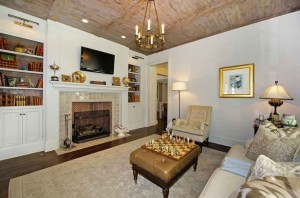 TV room with wood ceiling and fireplace