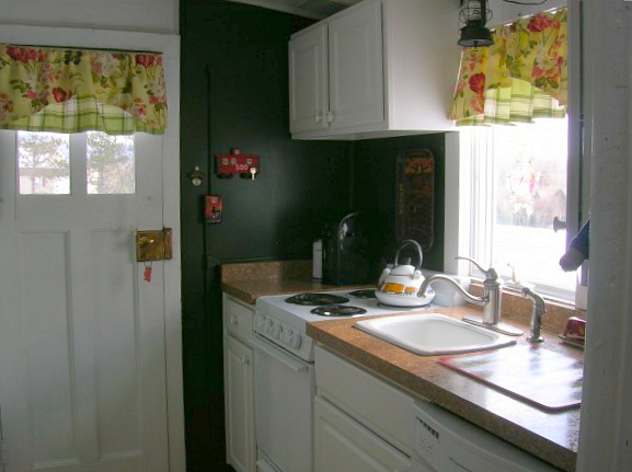 a train car turned into a tiny house-kitchen