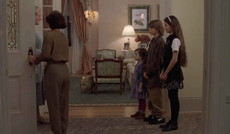 children standing in front entry of house as Mrs. Doubtfire enters