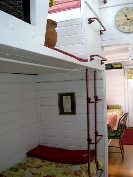 marcia's tiny traincar house bunk area