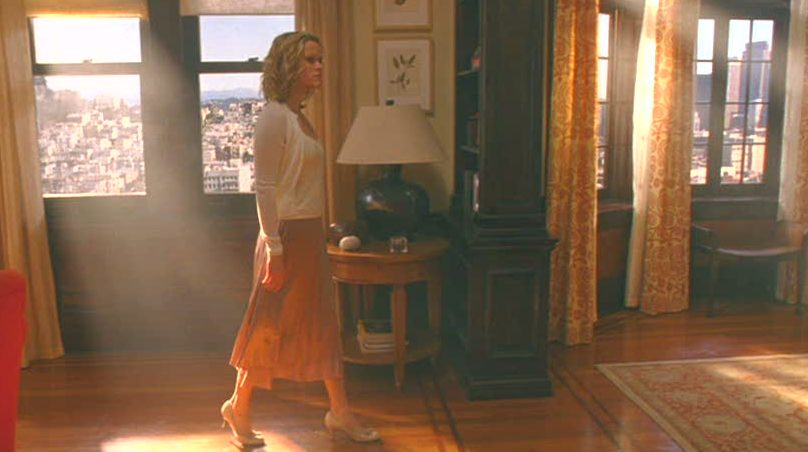 Reese Witherspoon walking through apartment