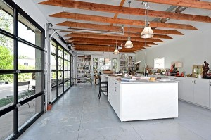 art studio with glass roll-up garage doors