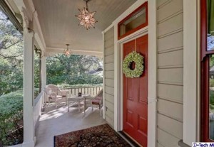 close up of red front door and front porch-cottage