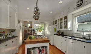 white kitchen with mudroom