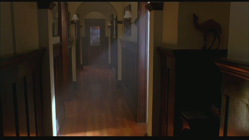 long apartment hallway with original woodwork