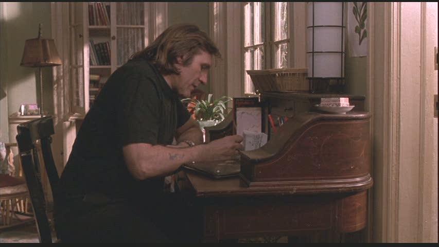 A man writing at a desk