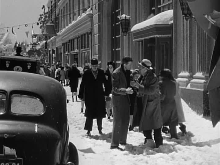 George Bailey on the street of Bedford Falls in the snow