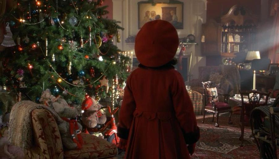 Susan walking into living room with Christmas tree