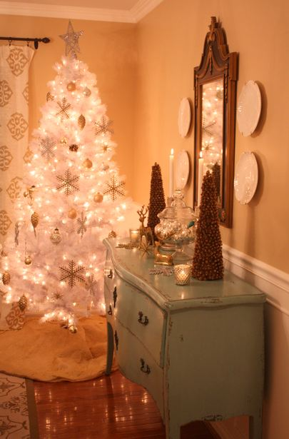 white Christmas tree in corner of dining room