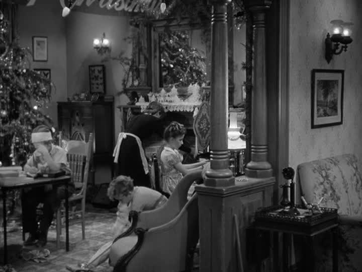 living room decorated for Christmas in It\'s a Wonderful Life