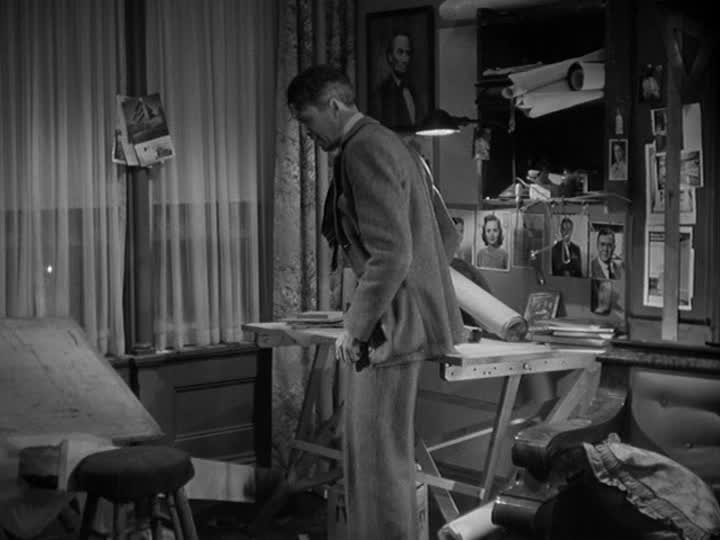 George Bailey pacing by his drafting table