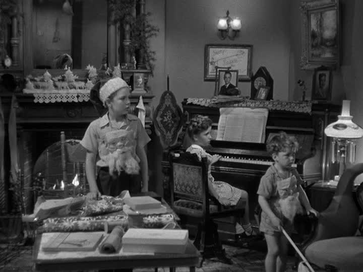 children in the living room in front of piano