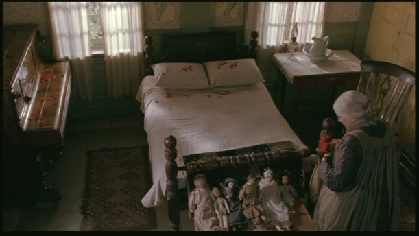 Overhead view of empty bed and dolls