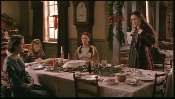 sisters around the dining table in Little Women