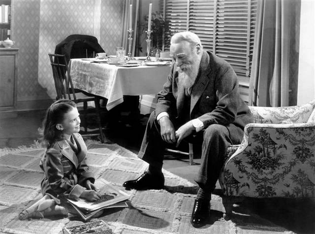 Natalie Wood laughing with Edmund Gwenn in Miracle on 34th Street