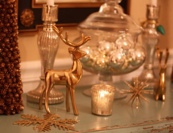 brass reindeer on table