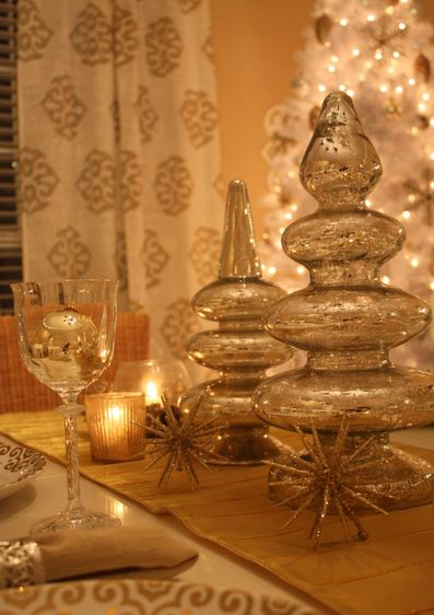 A table with mercury glass trees and candlelight