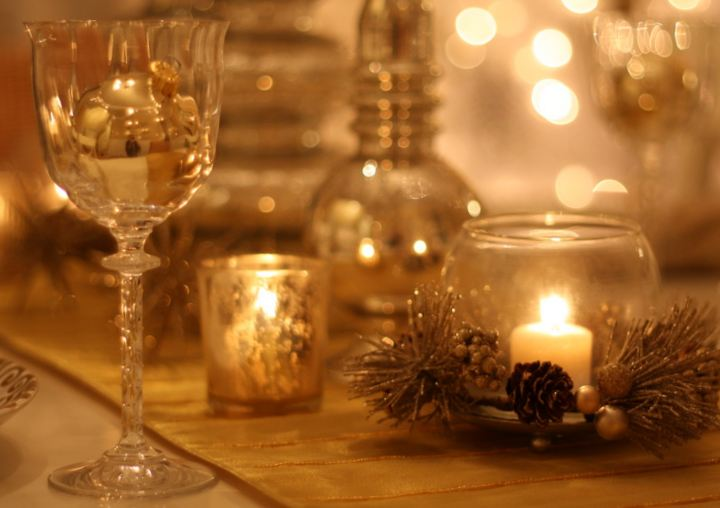 Closeup of wine glass and candle hooked on houses for Decorating dining room wine theme