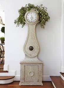 hall clock with greenery