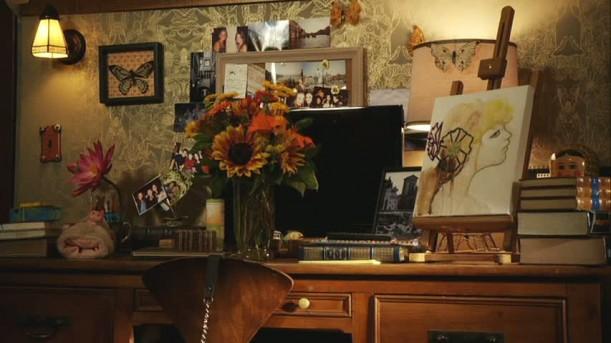 flowers in vase on Aria\'s desk