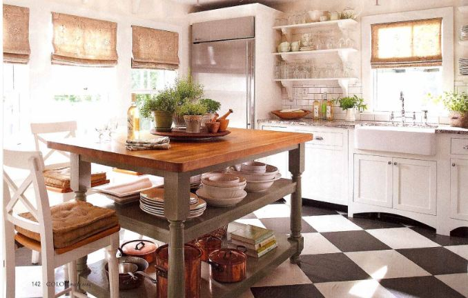 A kitchen with black and white checkerboard tile
