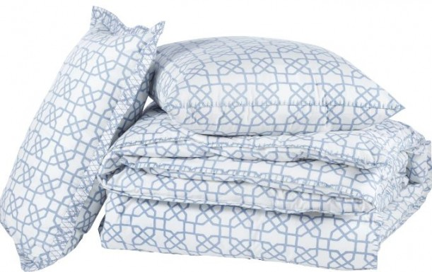 A close up of blue and white bedding