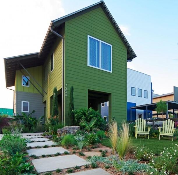 front exterior of Roger Hazard\'s modern farmhouse with green siding