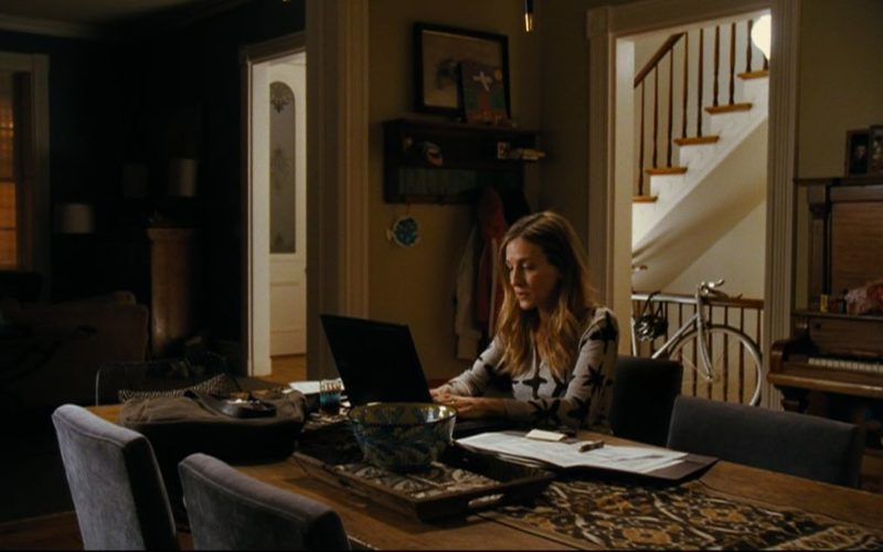 Sarah Jessica Parker working at laptop in dining room