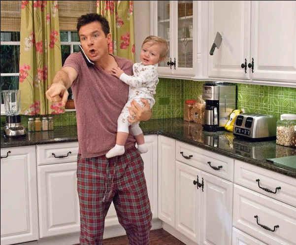 Jason Bateman standing in a kitchen