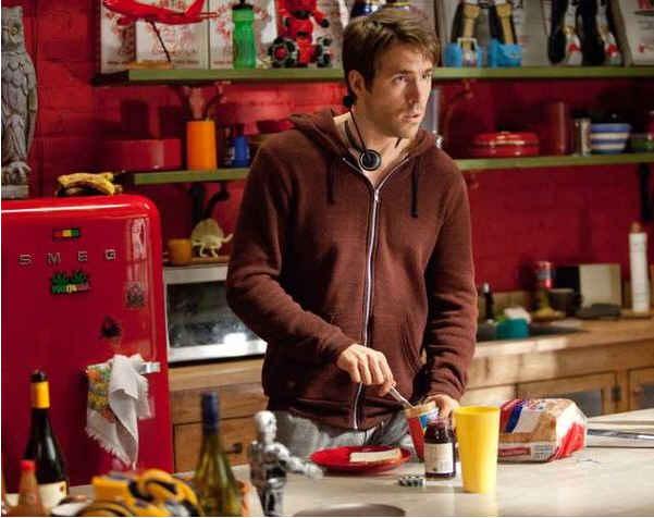 Ryan Reynolds standing in red kitchen with red Smeg fridge