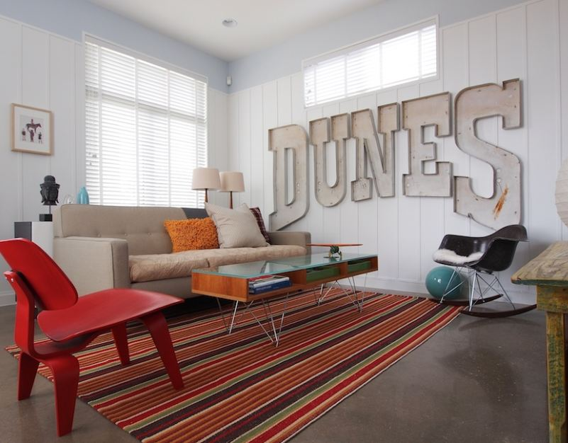 A living room with the word Dunes on the wall