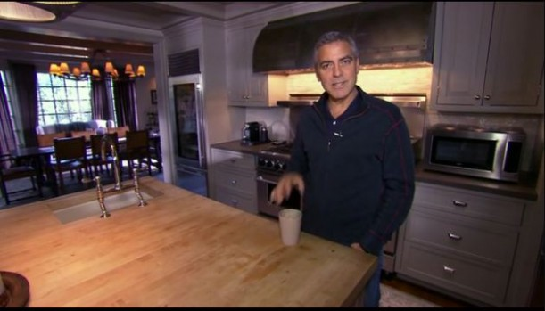 George Clooney standing in a kitchen