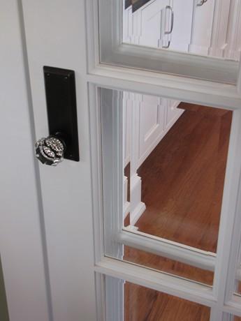A close up of a crystal doorknob