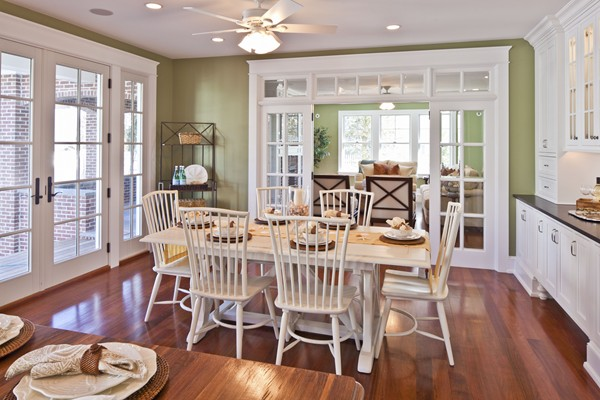 A dining room table and white chairs