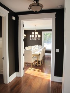looking into black-painted dining room