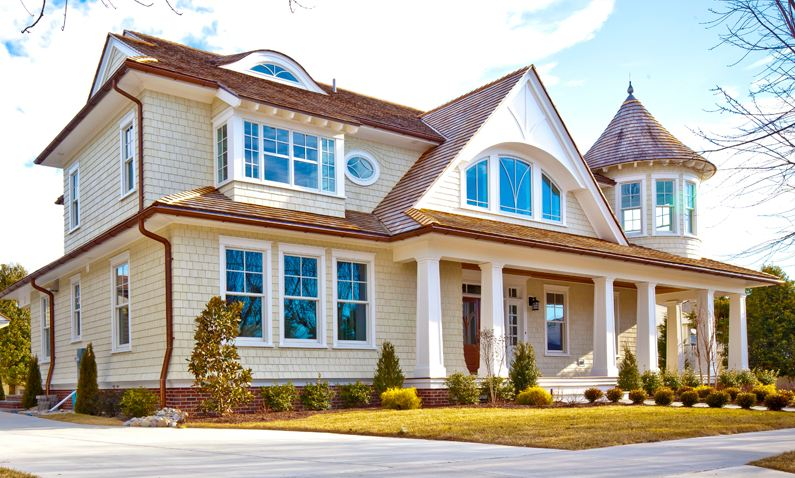 A new house with turn of the century style by buck custom for Century custom homes