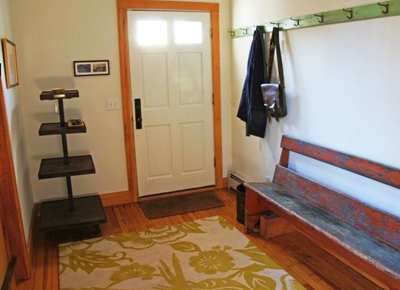 entry hall with bench and hooks for coats