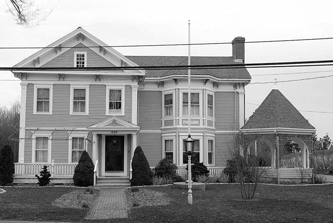 black and white photo of house before remodel