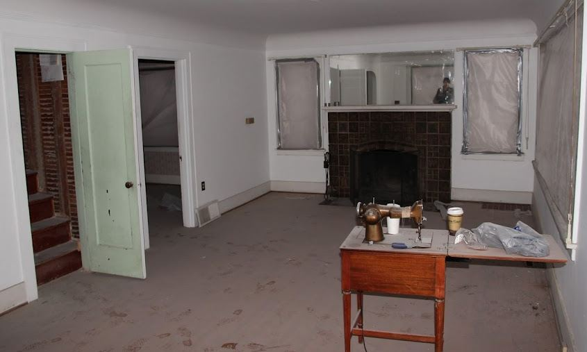 empty living room with fireplace before remodel