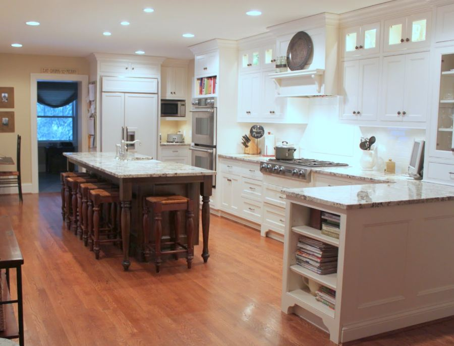 A kitchen with a wood floor in a room