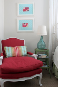 red chair in corner of daughter's bedroom